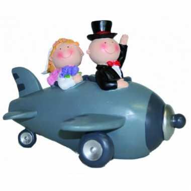 Bruid en bruidegom in vliegtuig spaarpot