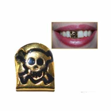 Gouden tandje met doodshoofd