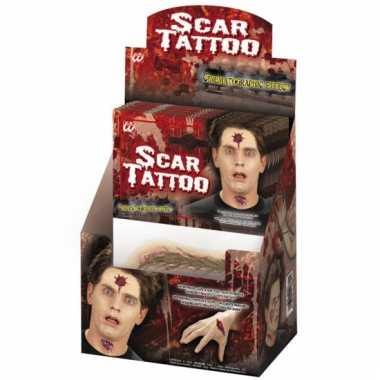 Plak tattoo littekens